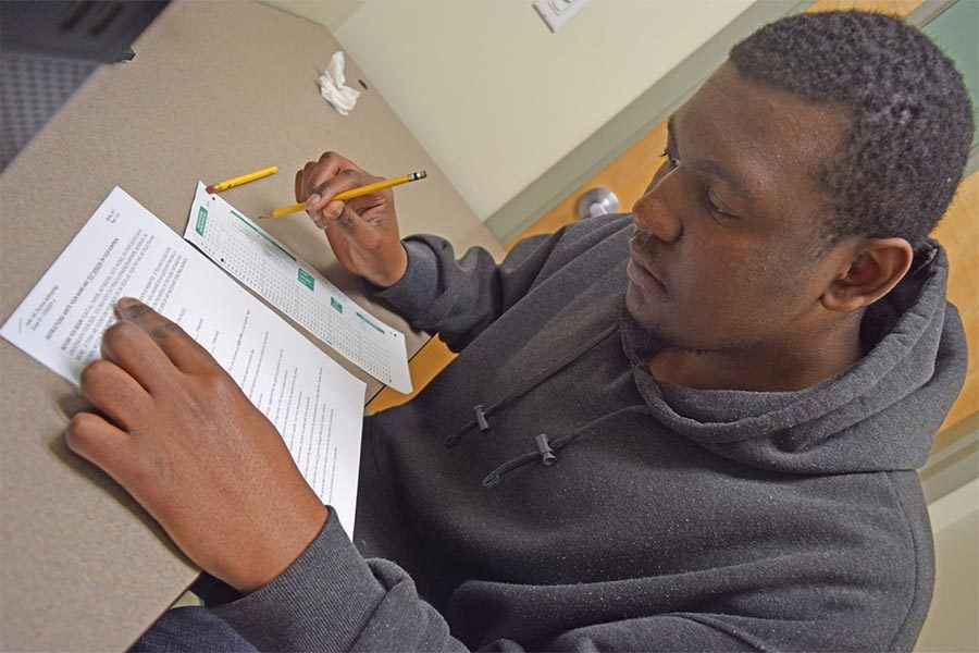 DEnis Perez / The Advocate Student Marquis Brown uses a room in the Student Services Center to take a test as part of a service provided by the Disabled Student Program Service  on March 2.