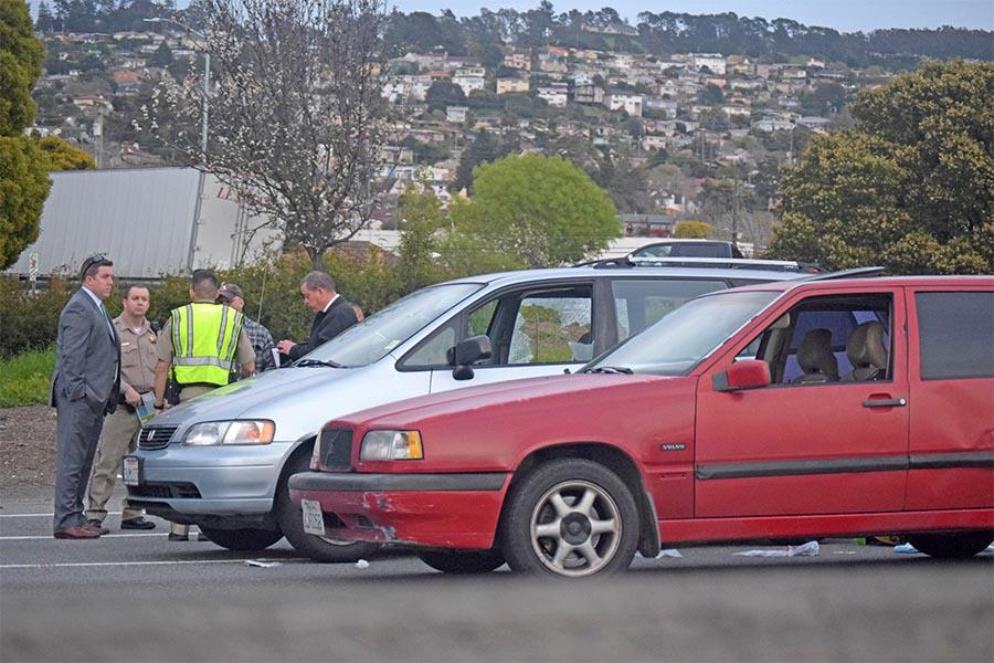 Authorities block the I-80 East bound freeway during a crime scene investigation of Contra Costa College alumni Demarcus Doss between Macdonald and San Pablo Avenue exits in Richmond, Calif. on Thursday.