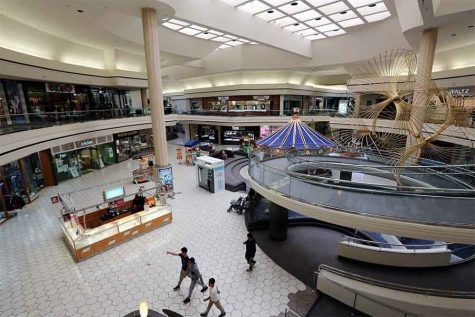 Few shoppers browse through the nearly empty Hilltop Mall on March 17. The number of shoppers at Hilltop Mall has steadily declined as storefronts become vacant despite Richmond Mayor Tom Butt's projection of future economic infusion.