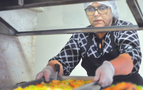 Denis Perez / The Advocate Richmond resident Roseline Soza places a full tray of rice into the buffet line at La Fusion restaurant on 23rd Street in Richmond.