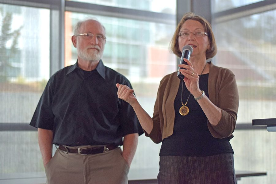 "denis perez / The Advocate Filmmakers Tyler Sterrenberg (left) and Laurie Simons introduce the  film ""Now is the Time: Healthcare for Everybody"" during a screening in Fireside Hall on Thursday."