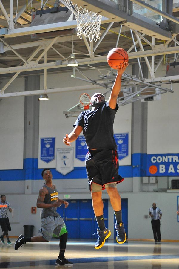 A+player+goes+up+for+a+layup+during+a+basketball+tournament+fundraiser+for+late+Demarcus+Doss+family+in+Contra+Costa+Colleges+Gymnasium+on+Saturday.