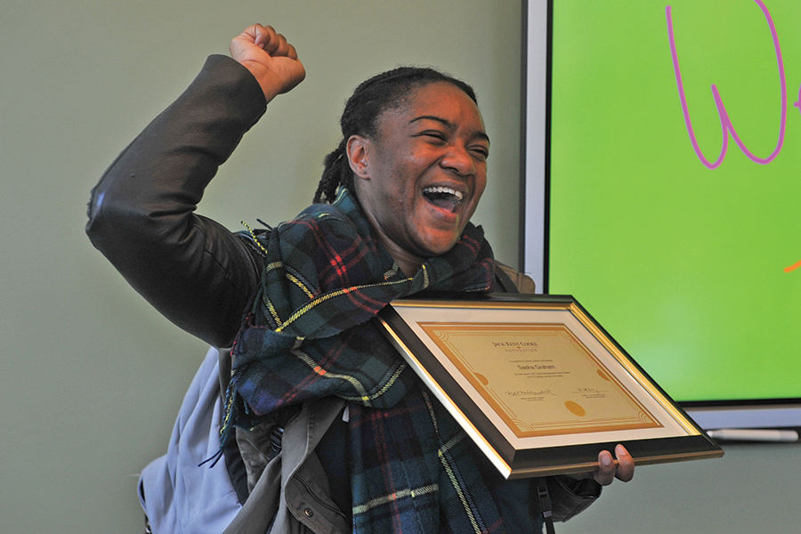 Liberal arts, social and behavioral sciences major Sasha Graham reacts to the news of winning the $40,000 per year Jack Kent Cooke Foundation Undergraduate Transfer Scholarship during a reception in the Student and Administration Building on April 18.