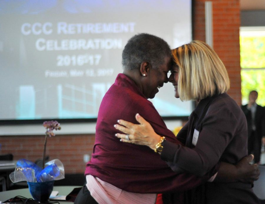 Contra Costa College retiring English professor Heather Roth (right) and English emeritus professor Barbara McClain (left) share a moment of jubilation during the retirement reception in Fireside Hall  on Friday, May 12, 2017.