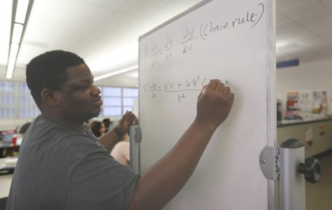 Robert Clinton / The Advocate Comet lineman and calculus tutor Barnabus Jime solves a calculus equation with other Comet football players during a tutoring session in the College Skills Center on Monday.