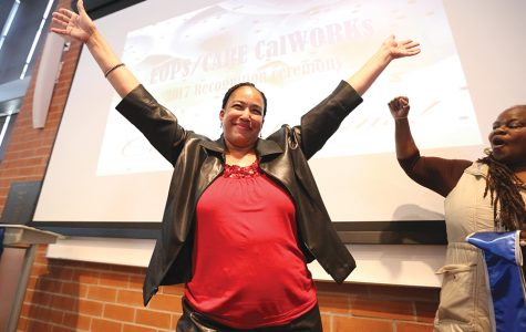 Sociology major Shelly Baker raises here hands in celebration as she recives her sash during the EOPS/CARE CalWorks 2017 Recognition ceromony.