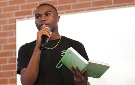 Student life ambassador Nijzel Dotson recites a poem he wrote to the crowd during the