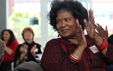 Health education department Chairperson Sandra Everhart applauds as Aminta Mickles introduces her  during the Retirement Reception and Staff Reunion event at Fireside Hall on Friday.
