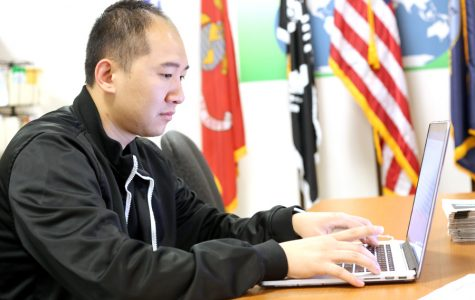 Navy Veteran and computer science major Gordon Su writes a per on his laptop in the Veterans Resources Center in SA-101 on Monday.