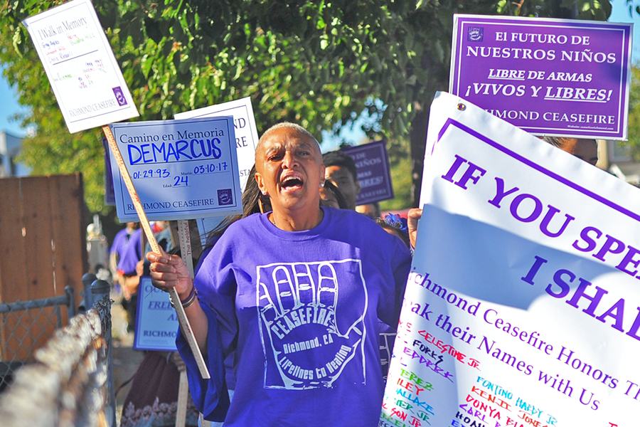 Concord+resident+Cynthia+Newton+chants+as+she+holds+a+sign+and+a+side+of+a+banner+during+the+Citywide+Walk+event+hosted+by+the+Richmond+Ceasefire+in+Richmond%2C+Calif.+on+July+21.+