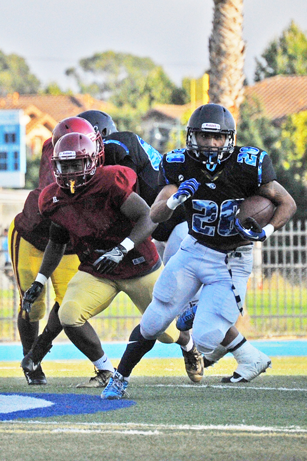 A Comet running back heads down field during a scrimmage against Los Medanos College on Aug. 23 at Comet Stadium.