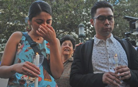 Fremont resident Mayra Alcaraz (left) wipes tears from her eyes while surrounded by friends and community members during a vigil at Frank Ogawa Plaza in Oakland, California on Thursday, Aug. 31, 2017, hours after news leaked that President Trump will repeal the Deferred Action for Childhood Arrival order. DACA recipients were asked to form a circle while the rest of the group surrounded them to sing
