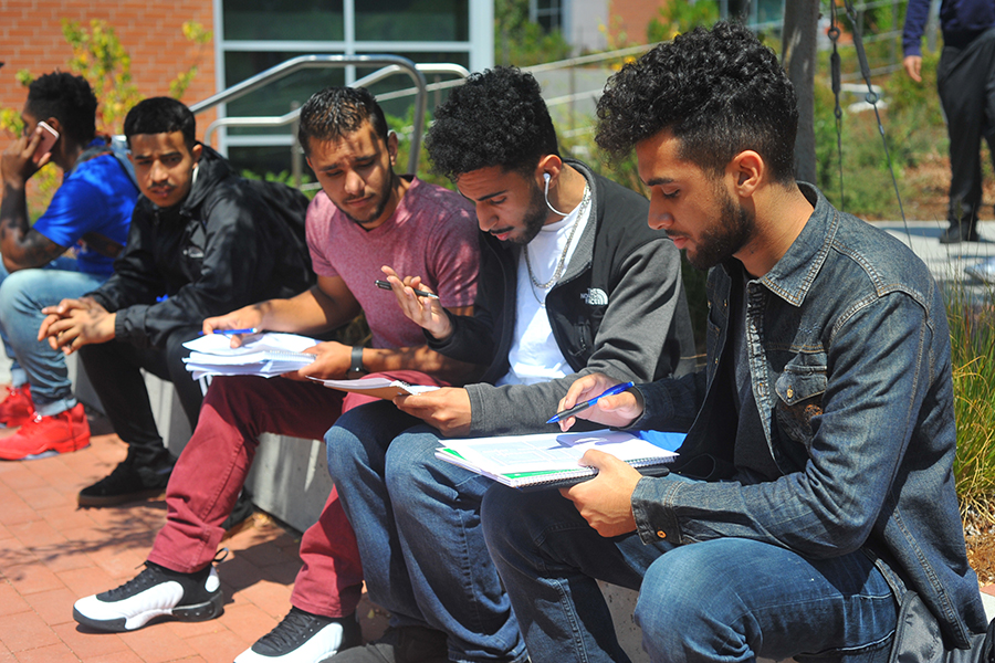 A group of students work together to solve crossword puzzles and enter a contest to win a Kindle Fire tablet during a Welcome Week event hosted by the Associated Student Union on Thursday.