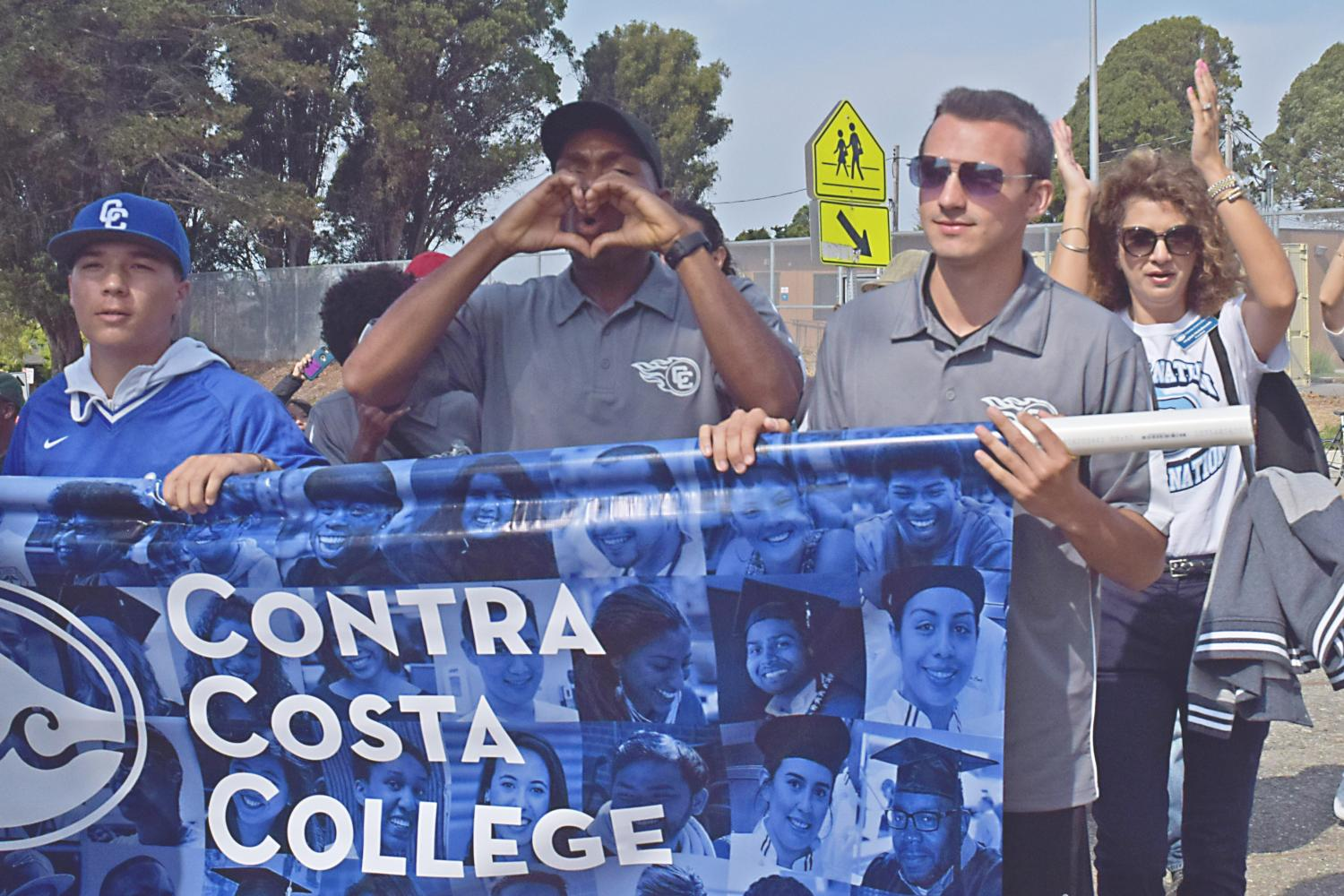A Contra Costa College student chants while marching during the El Cerrito Centennial parade in El Cerrito on Sept. 16.