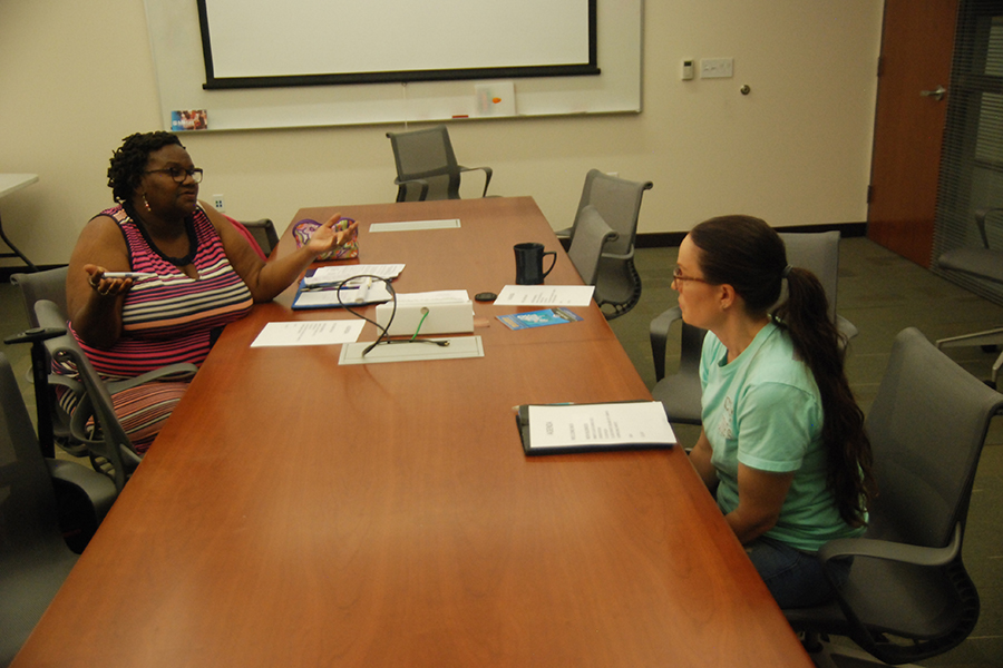 Health and Human Service Club President Denise Mills (left) talks with club Vice President Kristin Lobos during HHS Club meeting in SA-107 on Aug. 31.