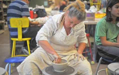 Volunteer Anne Van Blaricon throws a vase on a pottery wheel in the Art Building Monday for the Empty Bowls event, scheduled for Oct. 13 in the Aqua Terra Grill.