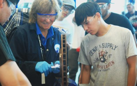 Automotive instructor Nancy Rupperecht demonstrates how to use a micrometer.