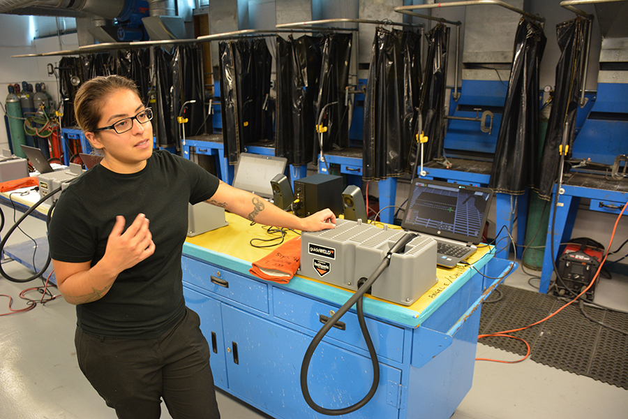 Automotive professor Laura Salas discusses the virtual reality software, Guildeweld, on Sept. 13. The software is being used to teach automotive welding techniques.