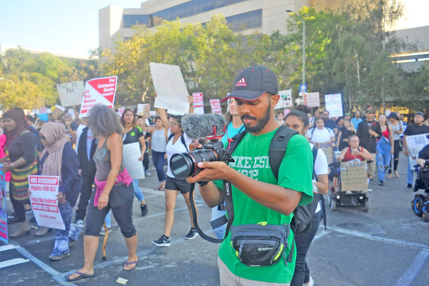 Richmond resident Taye Taye records a video during the Defend Daca rally and march to stand in solidarity with Deferred Action for Childhood Arrivals recipients in Oakland on Saturday. Taye gathers content for a political documentary following the election of Donald Trump.