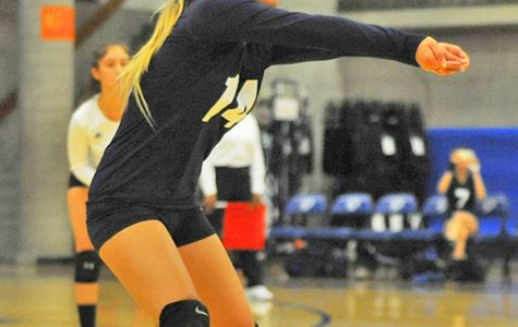 Comet outside hitter Victoria Matue digs the ball over the net during a game against College of Alameda.