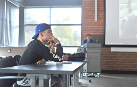 Communications major Andrew Magnoli listens to a seminar on American militarism in Latin America delivered by Mexican journalist Eduardo Garcia in the Fireside Hall on Sept. 18.