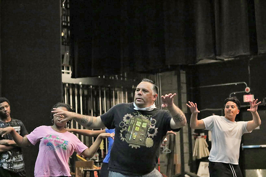 "Drama department Chairperson Carlos-Manuel Chavarria teaches the cast steps to a dance number at a ""Zombie Town"" rehearsal on Sept. 13."