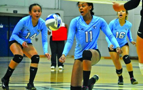 Comet middle hitter Makaya Thomas (middle) reacts to the ball's rebound with Comet outside hitter Victoria Matue (left) and defensive specialist Jacqueline Tianero (right) after hitting a ball into the net during Contra Costa College's 3-0 loss to Solano Community College on Friday.