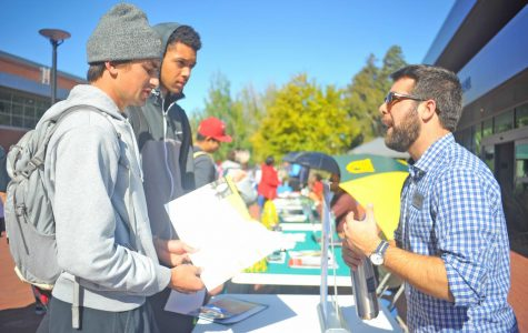Two students talk with a university representative during Transfer Day on Oct. 3.
