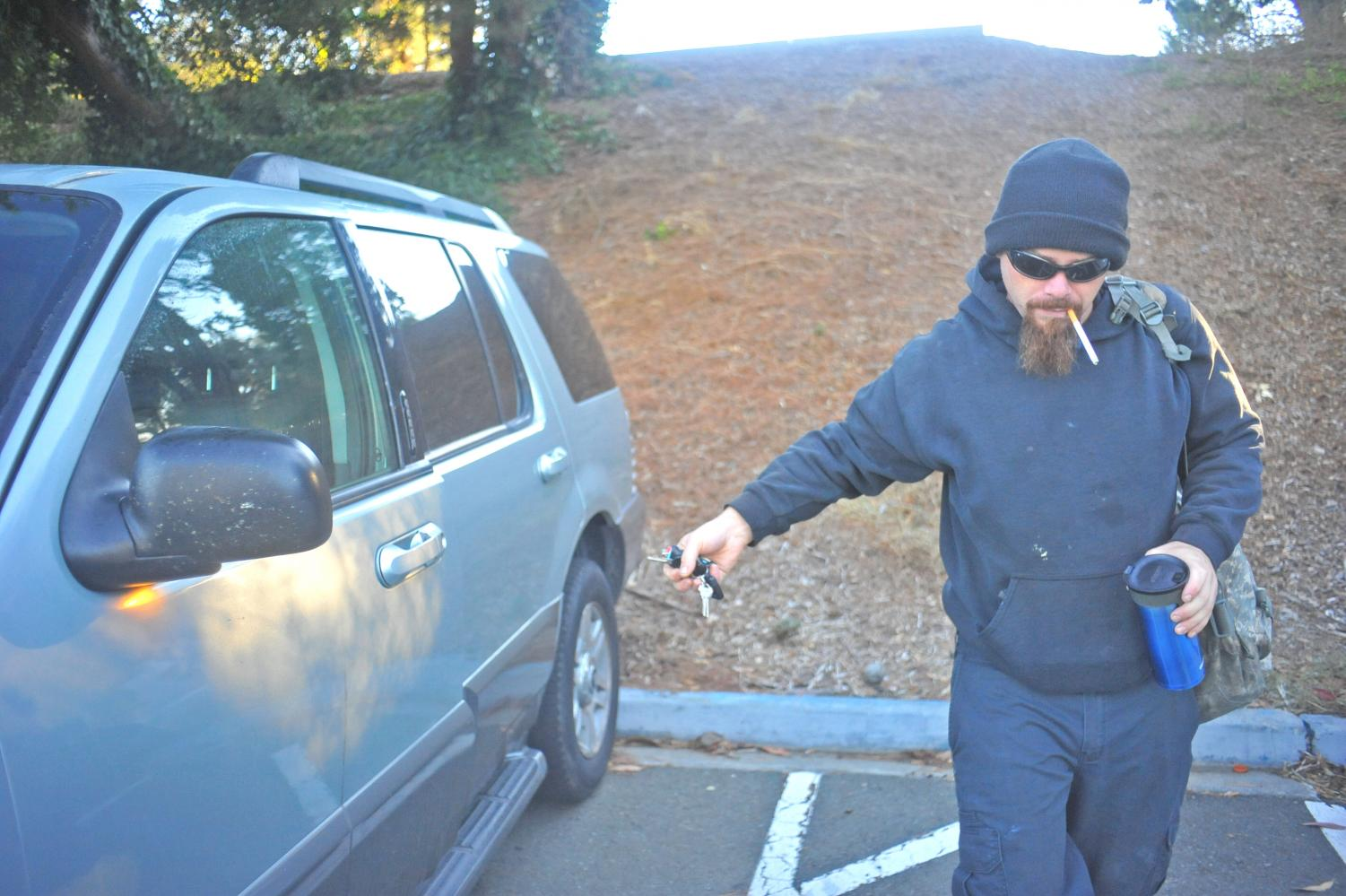 Before heading to class, automotive services major Theo Guillory closes and locks his door in Lot 17 on Monday. Guillory said from personal experiences he knows break ins are more common on the north side lots on campus.