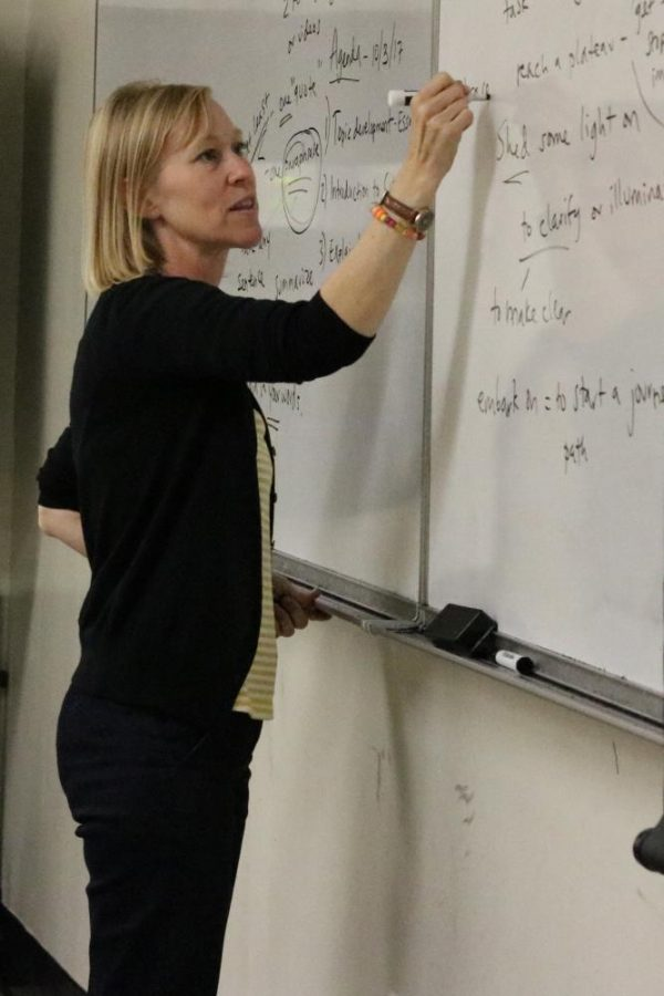 English as second language professor Shelly Ruby writes on the white board during a lecture in Essay Writing in AA-133 on Thursday.