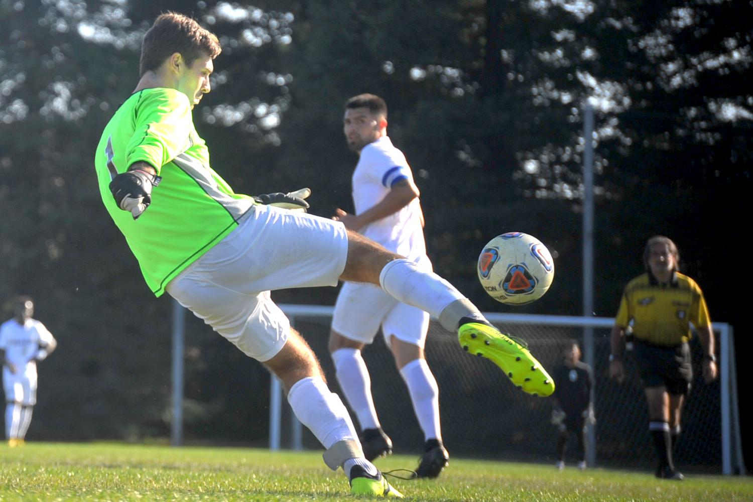 Mariner goalkeeper Colin Sneddon clears the ball from his goal area. Sneddon was scored on 5 times during Contra Costa College's 5-1 win against College of Marin in the Soccer Field on Tuesday.