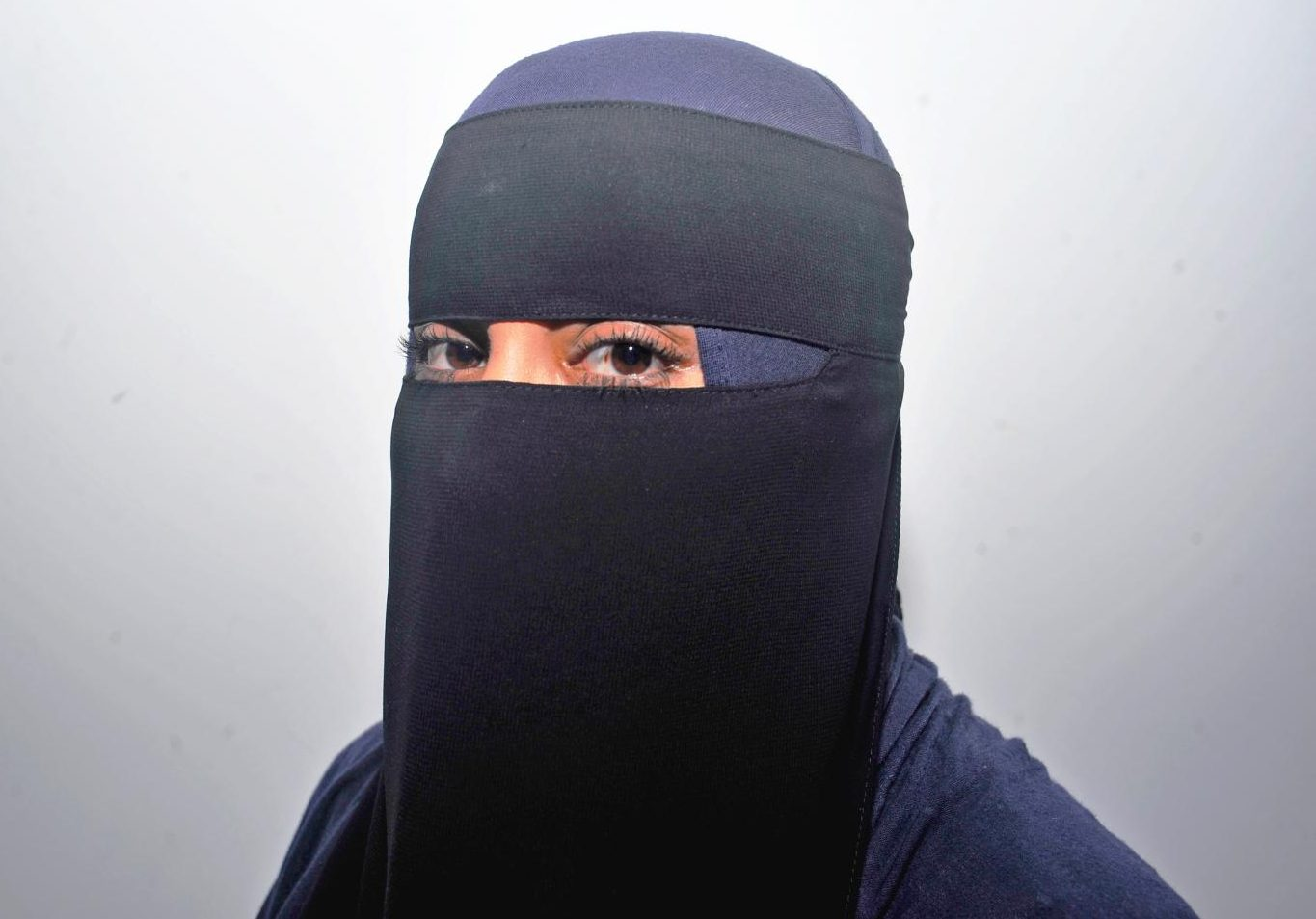 Muslim Student Association President Rayah Alammari wears a Niqab, a full body garment with a veil that only shows her eyes, by choice every day as part of her devotion to the Islamic faith.