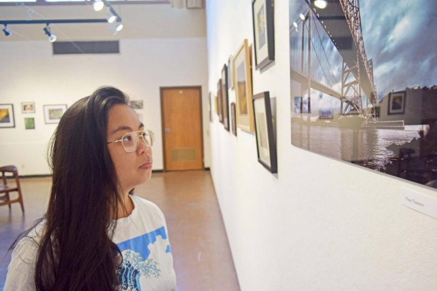 Art major Shienna Nang looks at Tony Tamayo's photograph at Eddie Rhodes Gallery in the Art Building on Nov. 2.