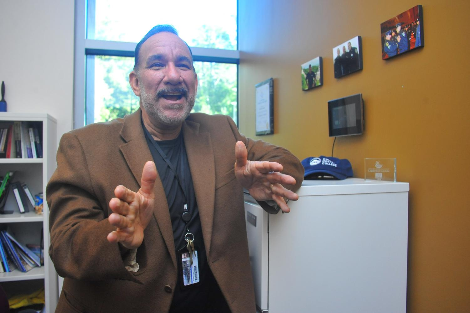 Rick Ramos explains the position he will take at Merritt College in Oakland starting next semester.  Ramos also recalls his many experiences working at Contra Costa College  for 30 years as he stands in his GE-113 office on Friday.
