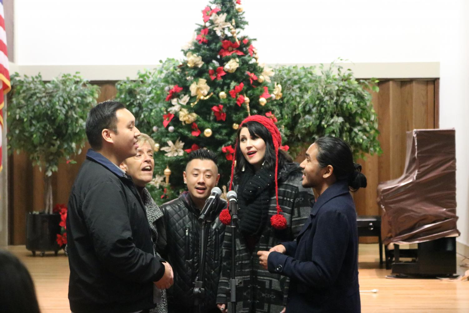 Jazzology tenor Joseph Saeteurn (left), alto Laura Karst (middle left), baritone Jesse Chao (middle), lead soprano Natasha Singer (middle right), and baritone Ninoangelo Lastimosa (right) sing during the San Pablo tree lighting on Friday.