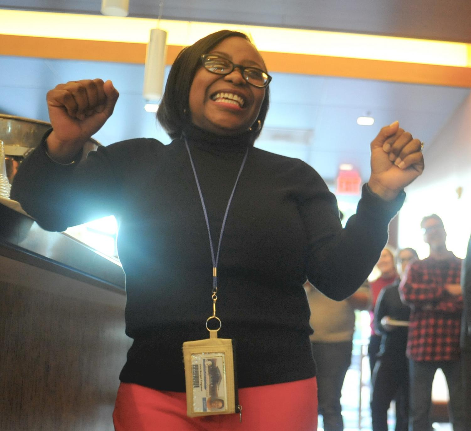Former Dean of Student Services Vikki Ferguson dances during a song being sung to her by attendees of her going away celebration in Aqua Terra Grill.