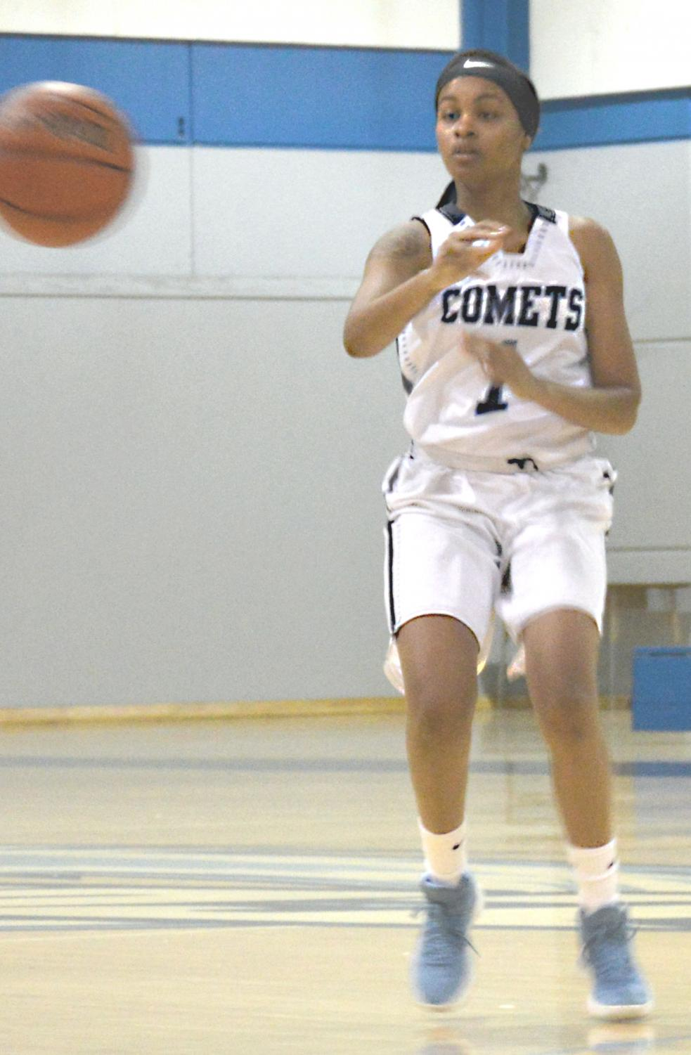 Comet forward Krisyle King passes off the ball to a team mate, as Eagles defenders rush in during Contra Costa College's loss to Laney College 69-62 in the Gymnasium on Jan. 24.