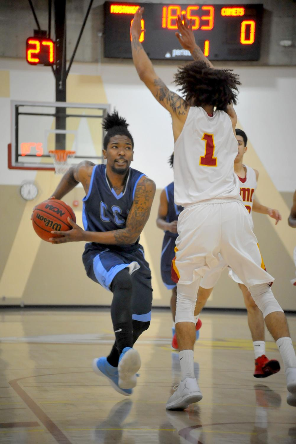 Comet player takes a contested layup during the Comets' 72-62 loss at Los Medanos College on Friday.