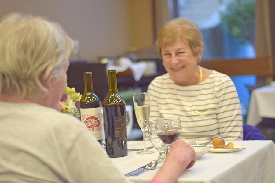 Pinole resident Carol Jenning (right) enjoys conversation with a friend during the 2nd Annual Cupid's Season Dinner on Feb. 11, 2016.