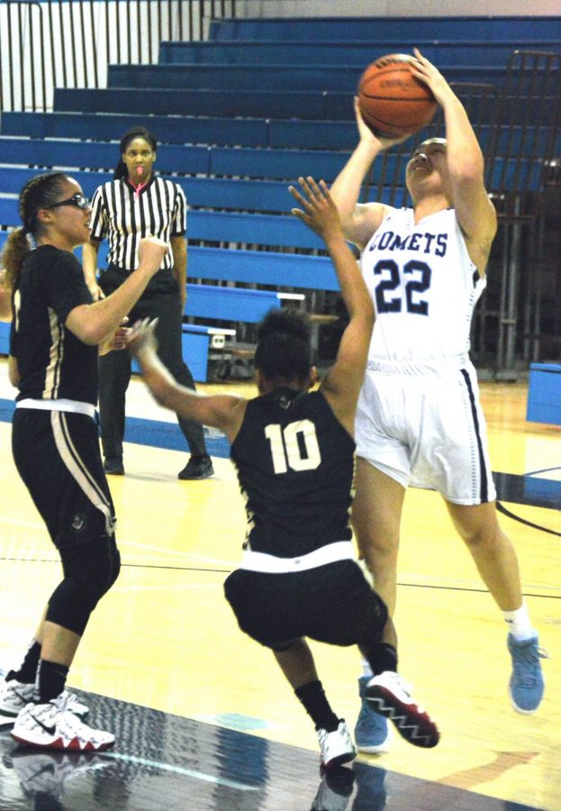 Comet forward Jahnna Maramba shoots as two Mariner guards approach her during Contra Costa College's 61-51 loss against the College of Marin in the Gymnasium on Friday.