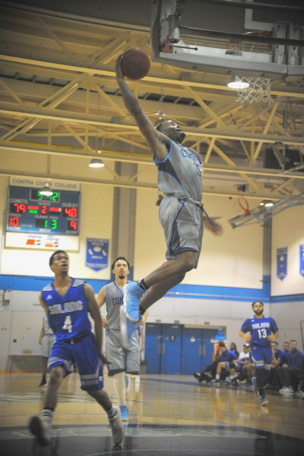 Guard Kemare Wright dunks during Contra Costa College's 92-63 victory against Solano Community College on Jan. 31 in the Gym.