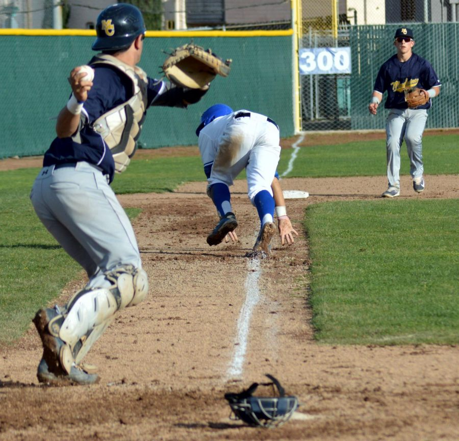 Comet infielder London Penland (middle) runs back to third attempting to stay safe in the ninth inning of Thursday's loss to Mendocino College on the Baseball Field. The Comets lost 1-0.