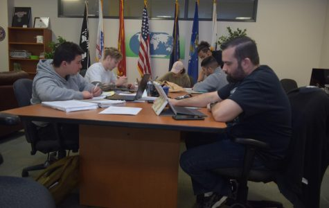 Chris Babcock, a mechanical engineering major (right) and John Mortera, an electrical engineering major (left) study on their laptops in the Veterans' Resource Center.