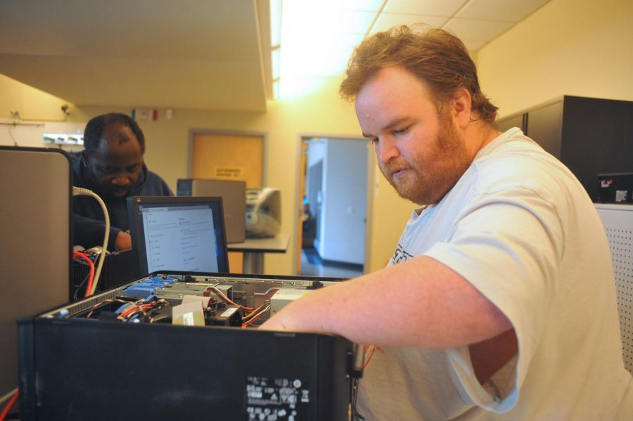 Two students work on a computer server during the newly launced