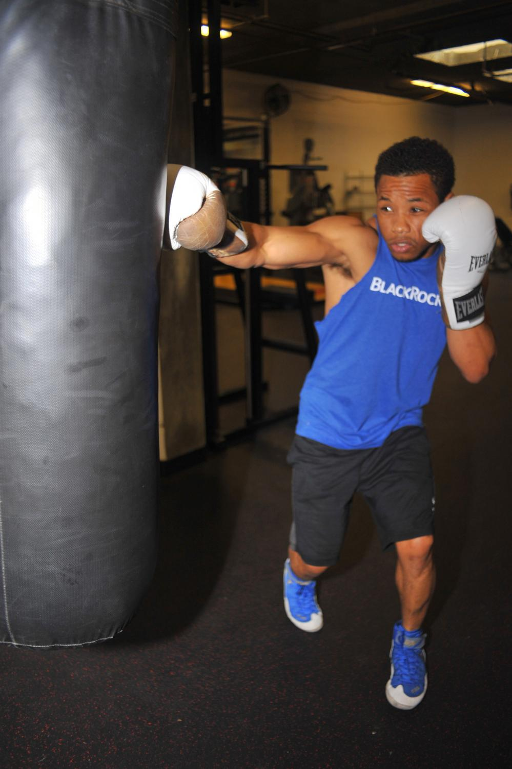 Professional welterweight boxer Karim Mayfield delivers a right straight to a heavy bag in the 3rd Street Gym in San Francisco on Thursday.