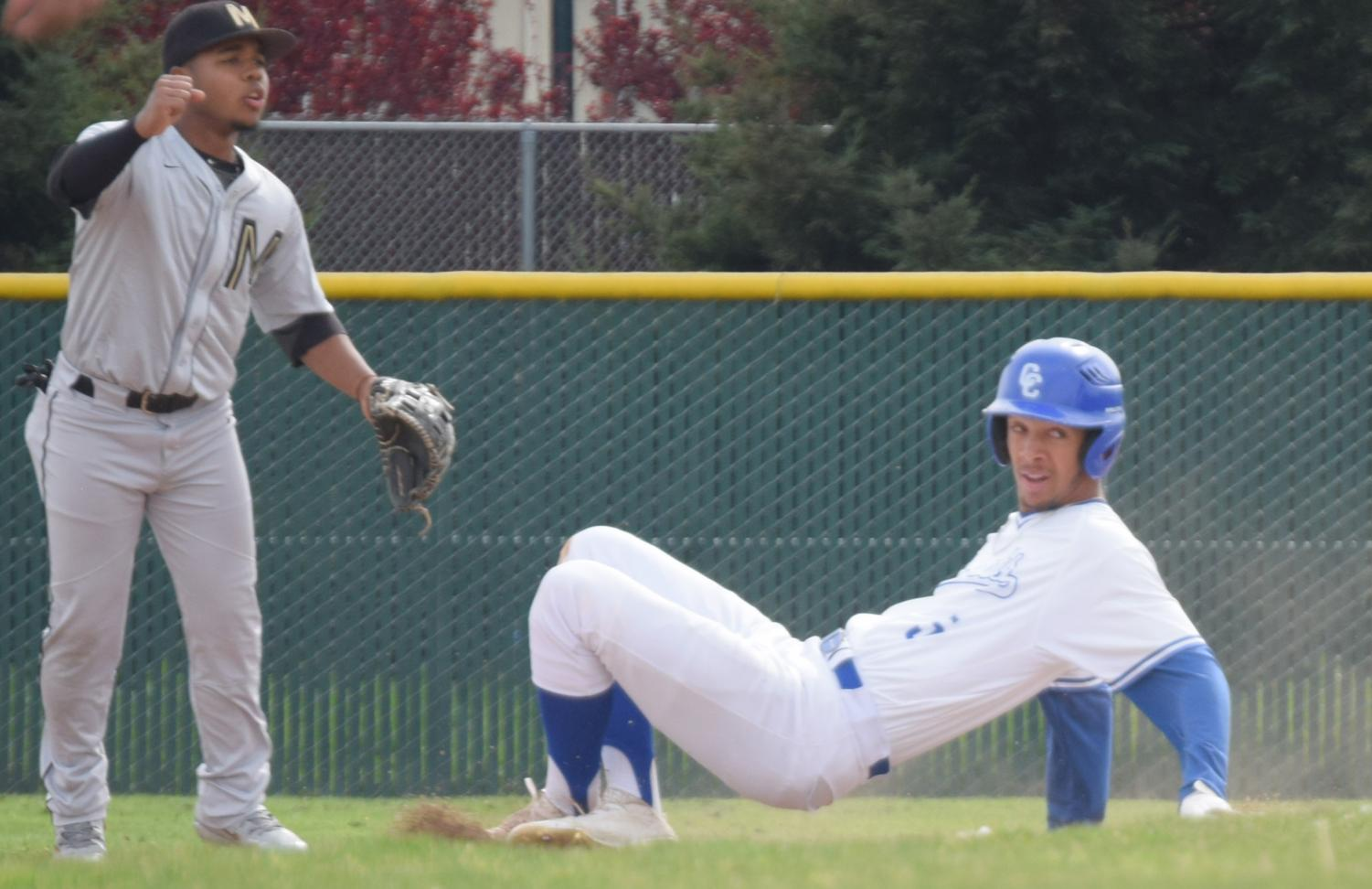 Comet outfielder Mychael Jamison slides in safely after stealing second base during Contra Costa College's 12-3 defeat to the College of Marin on Monday at the Baseball Field.