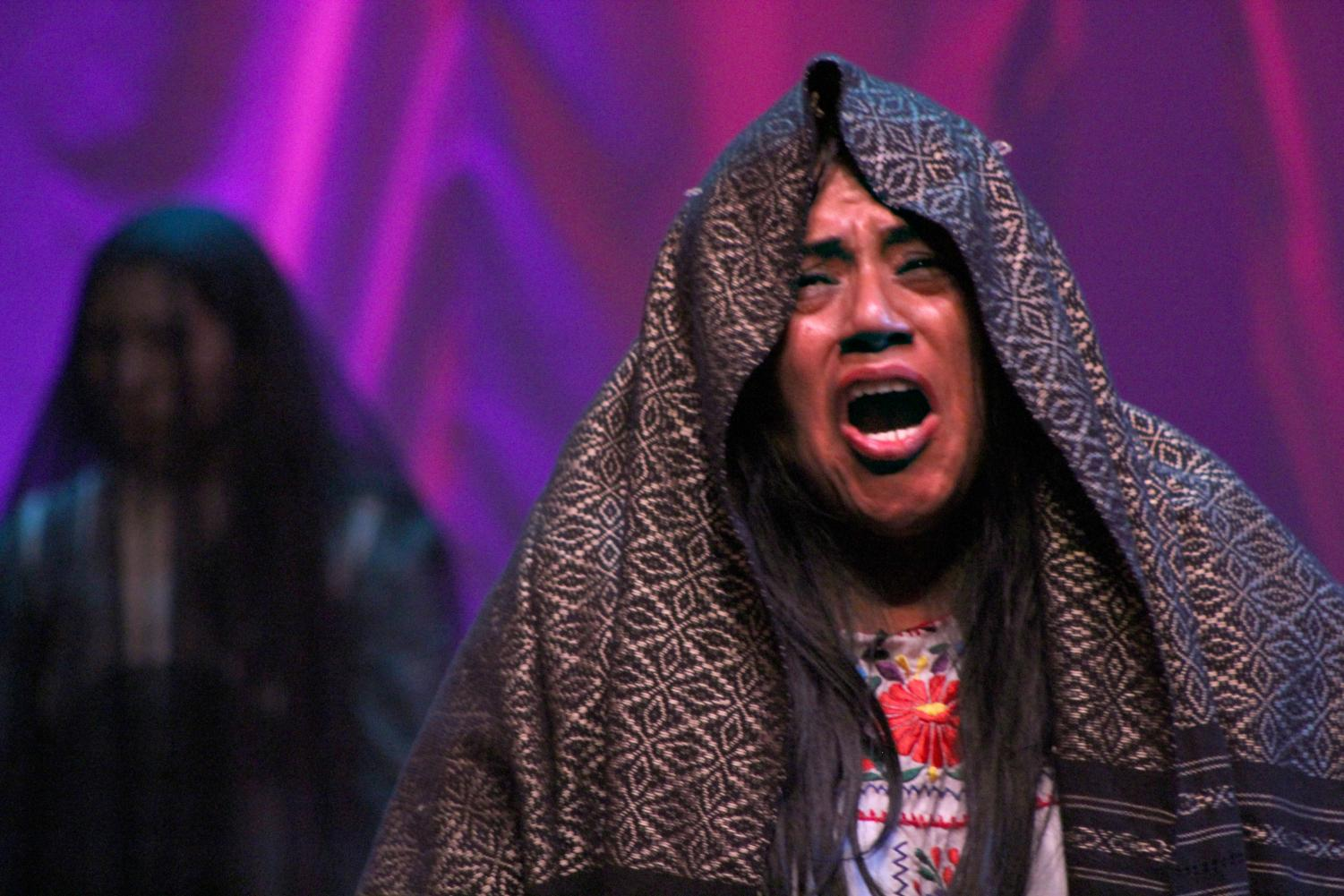 "La Llorona, played by Silvia Sobal, weeps as she wanders eternally looking for her drowned children in ""The Cries of La Llorona,"" currently running in the Knox Center. The play continues Friday, Saturday and Sunday."