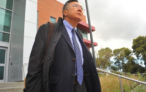 Contra Costa College Interim President Chui L. Tsang walks to his car after his first day at CCC in San Pablo, California on March 16. Tsang, a CCC alum, suspended his retirement to fill the position until a permanent president is selected by July.