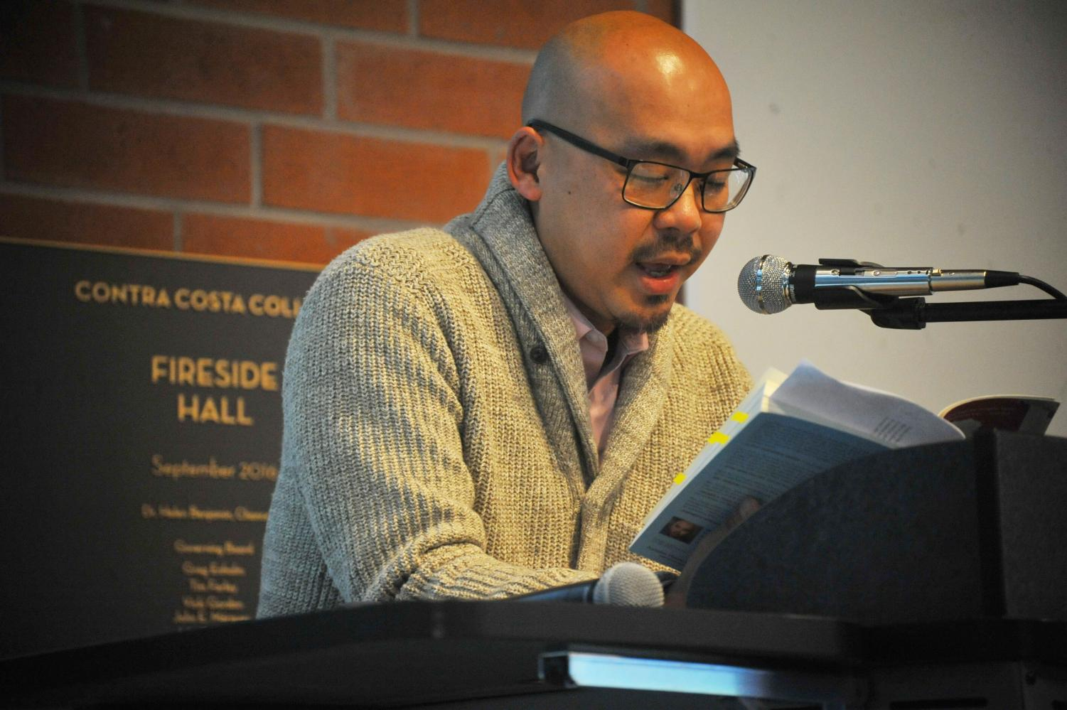 "English professor Dickson Lam reads from his book, ""Paper Sons: A Memoir"" during his book signing event at Fireside Hall on Thursday."