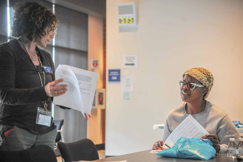 EOPS counselor Julie Skoler (left) helps a student during a compressed calendar informational session workshop at Fireside Hall on Thursday.
